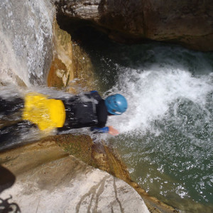 Canyoning head first toboggan