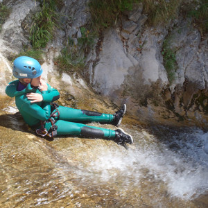 Canyoning preparing to toboggan