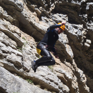 Canyoning and jumping in mid air