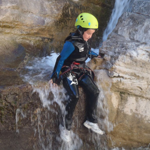 Canyoning doing a toboggan