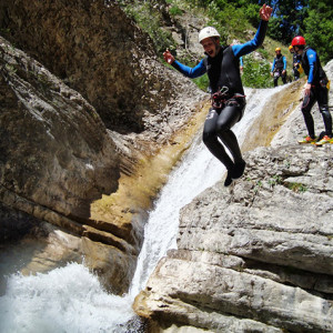 Canyoning jumping off the cliff