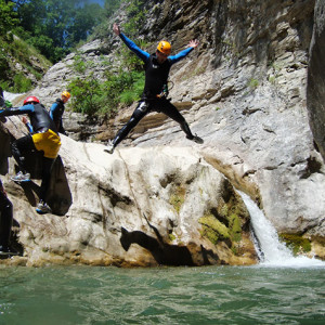 Canyoning star jump in the air