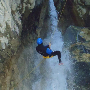 Canyoning abseiling waterfall