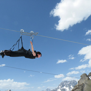Giant tyrolean zip line on an activity holiday in the french Alps