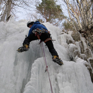 ice climbing on ice falls in the Alps
