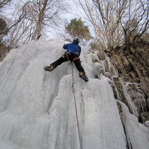 Ice Climbing climbing up an ice fall