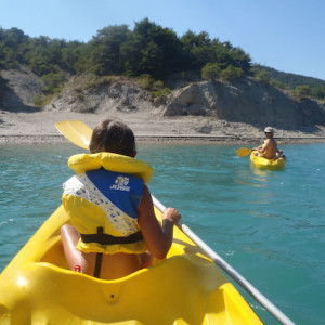 Lake Kayaking on the Lac du Serre Poncon blue wate
