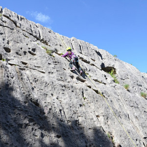 Rock Climbing kids nearly at top of block in Ceuse