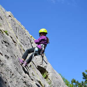 Rock Climbing child abseiling down