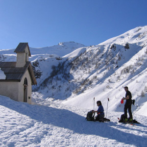 Ski Touring stop at a little chapel
