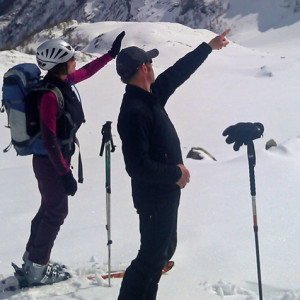 Ski touring pointing at the summits