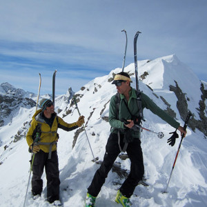 Ski touring a guide discussion with skis on the ba