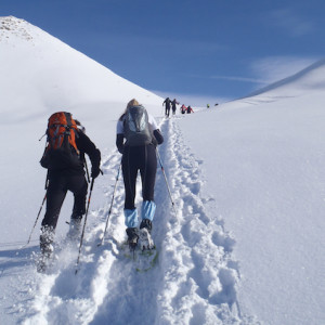 Snowshoeing across snow fields in the Alps