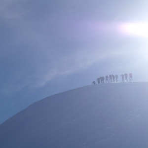 Snowshoeing group on the top of a mountain
