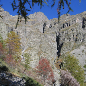 Walking in the French Alps rocky cliff in autumn