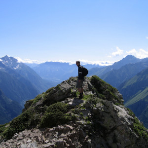 Walking in the French Alps on a rock