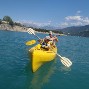 Kayaking on the lake on an activity holiday in the Southern french Alp