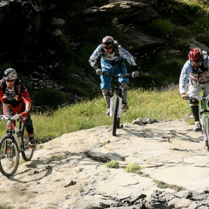 mountain biking three downhill bikers