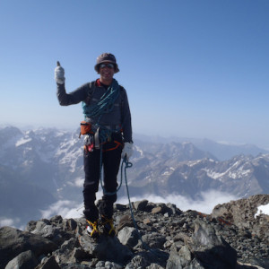 Mountaineering guide on the summit