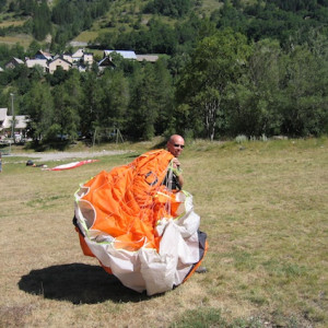 Paragliding course learning to carry the parachute