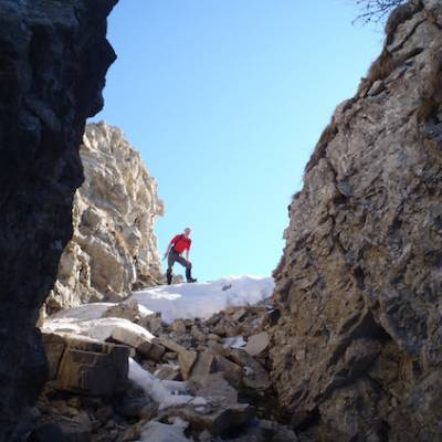 Snowshoeing in the French Alps in rocky outcrops