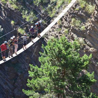 Via Ferrata Sautet rope bridge with people on it