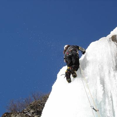 Ice climbing with blue sky