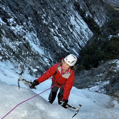Ice Climbing  hitting the ice