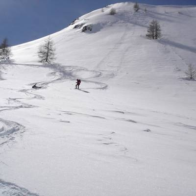 Ski Touring - skiing down and falling down