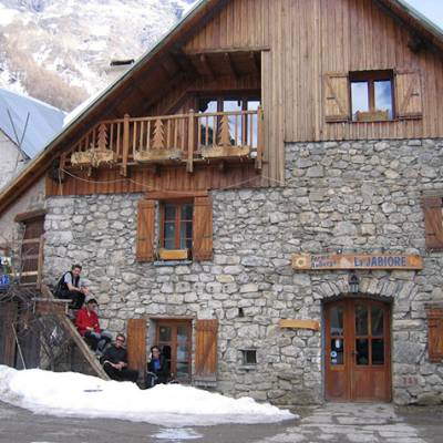 Ski Touring a welcome drink in a refuge