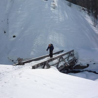 Ski touring crossing a bridge