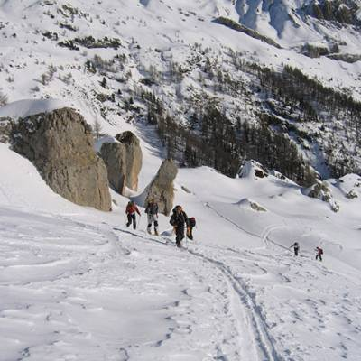 Ski Touring group skinning up to La Palastre