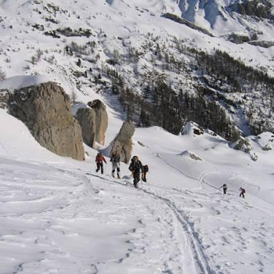 Ski Touring group skinning up to La Palastre