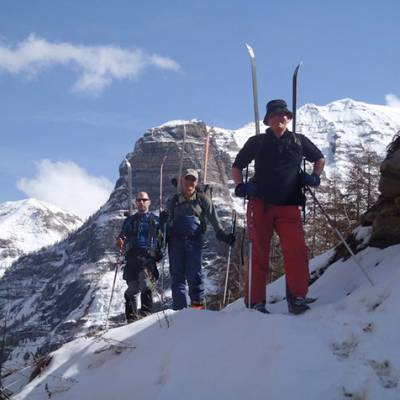 Ski touring skis on back to negotiate stream