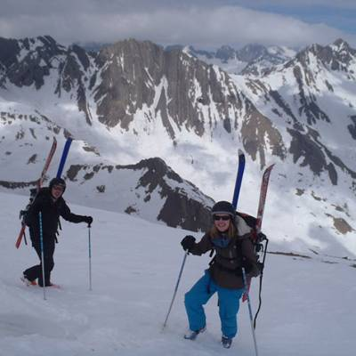 Ski touring up to Roc Diolan skis on back