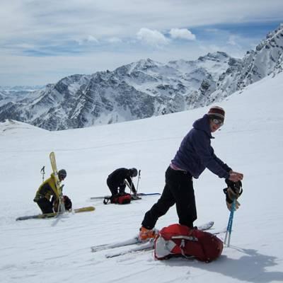 Ski touring putting on skins in deep snow