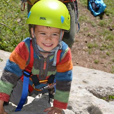 Rock Climbing little kid smiling and climbing