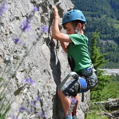 Rock Climbing child in green climbing