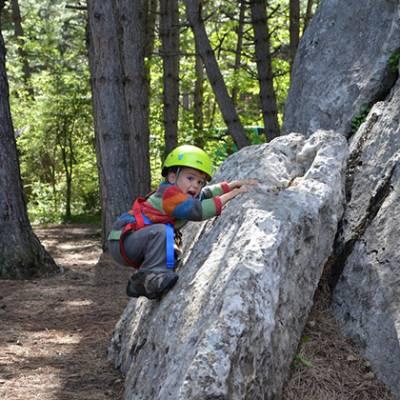 Rock Climbing little kid bouldering move