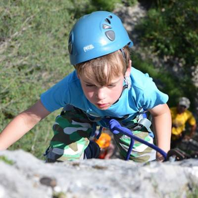 Rock Climbing kid reaching the top