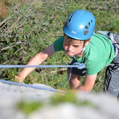 Rock Climbing kid concentrating on climbing