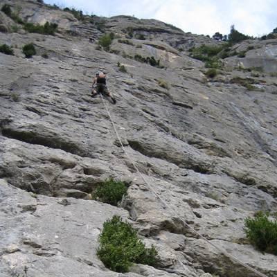 Rock Climbing half way up cliff