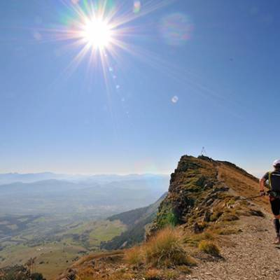 Trail Running in the Alps with sun