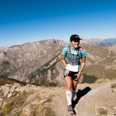 Trail Running girl on ridge