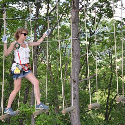 High Ropes Adventure stepping across the rope swin