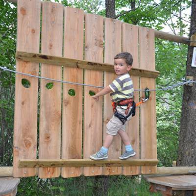High Ropes Adventure negotiating the wooden fence
