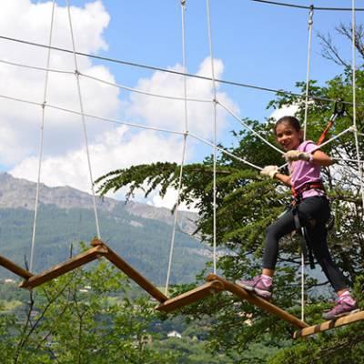High Ropes Adventure crossing the zig zag bridge