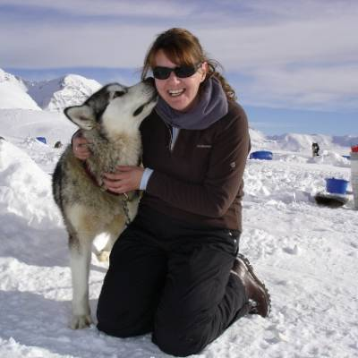 Husky Dog Sledding lady with husky