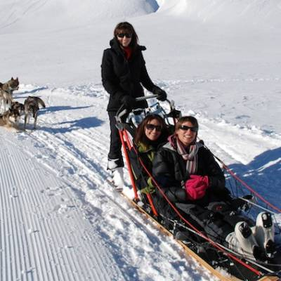 Husky Dog Sledding girls in sled
