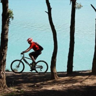 mountain biking next to lake
